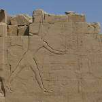 Figure 2. Thutmes III imposing order over chaos, the enemies of Egypt, on the seventh pylon at Karnak