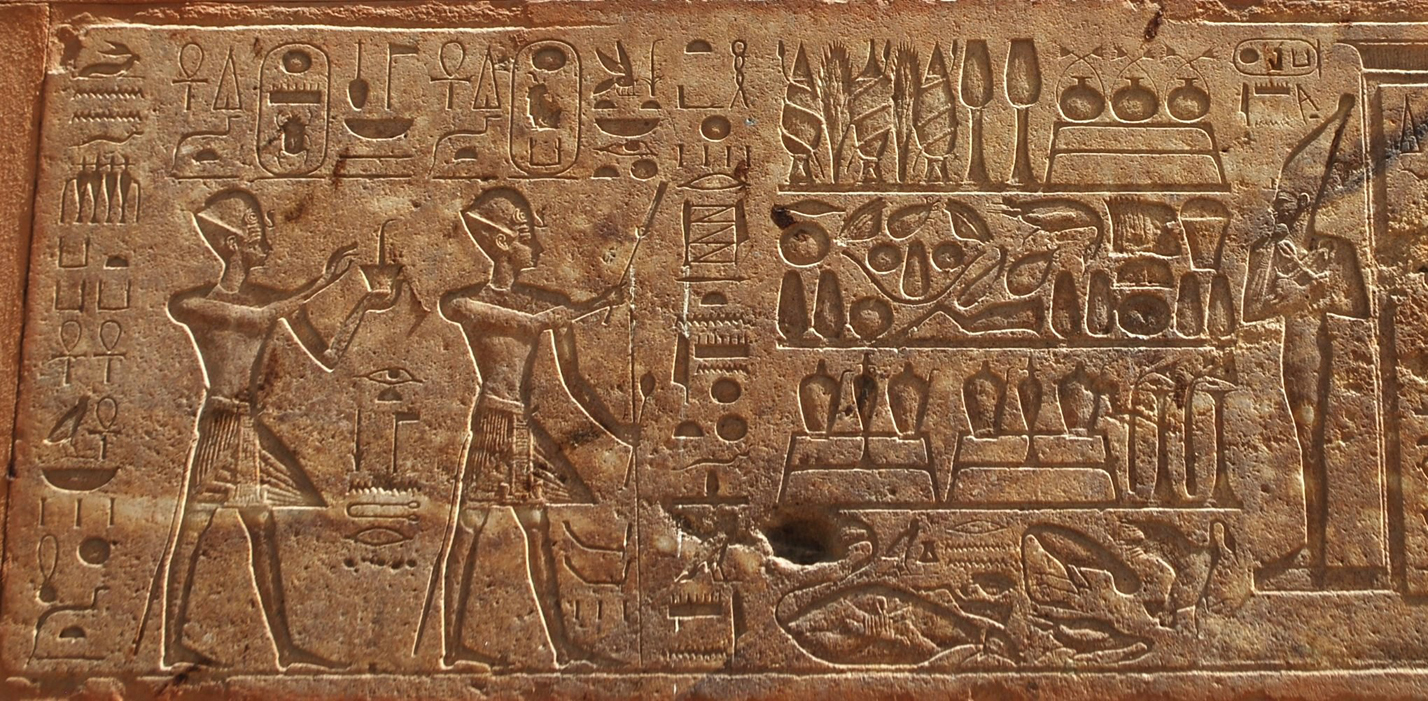 Red Chapel scene showingThutmosis III and Hatshepsut making offerings to the Temple of Deir el Bahari including a  mummiform colossus