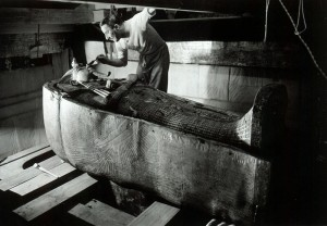 Howard Carter inspecting one of the coffins of Tutankhamun