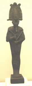 A late Period bronze that shows Osiris with his right hand higher than his left